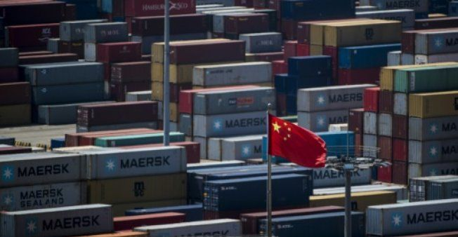 Asian markets turn negative as data shows China growth slowingg