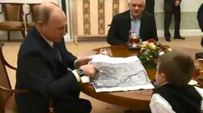 Putin fulfills ailing boy's wish - VIDEO