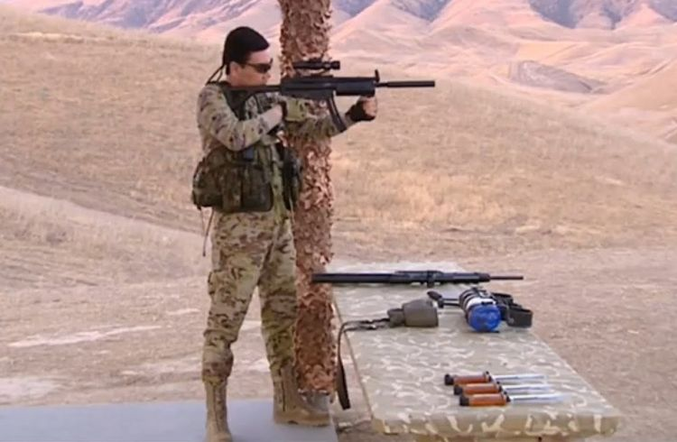 Bizarre footage of Turkmenistan's President - Shooting targets while riding bicycle - VIDEO