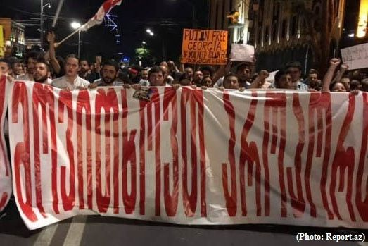 Protesters marched against Putin and Ivanishvili in Tbilisig