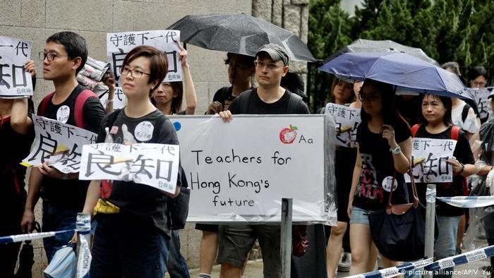Hong Kong protests call for democracy, rally for China