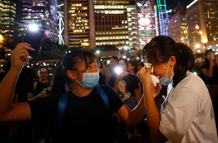 Hong Kong braces for fresh protests - Canada stops staff travel to mainland China