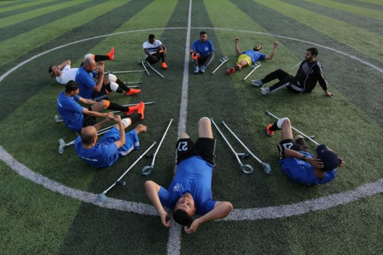 Palestinian amputee children find freedom in football