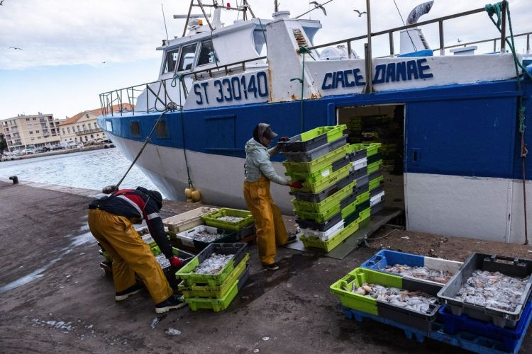 France threatens U.K. on financial services in fisheries dispute