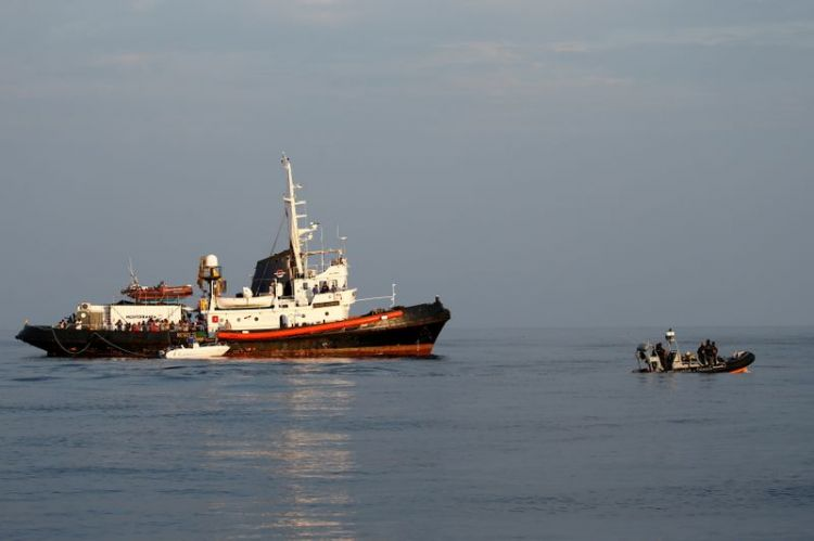 Boats carrying hundred of migrants arrive in Italy's Lampedusa